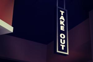 take out signage at night lit up